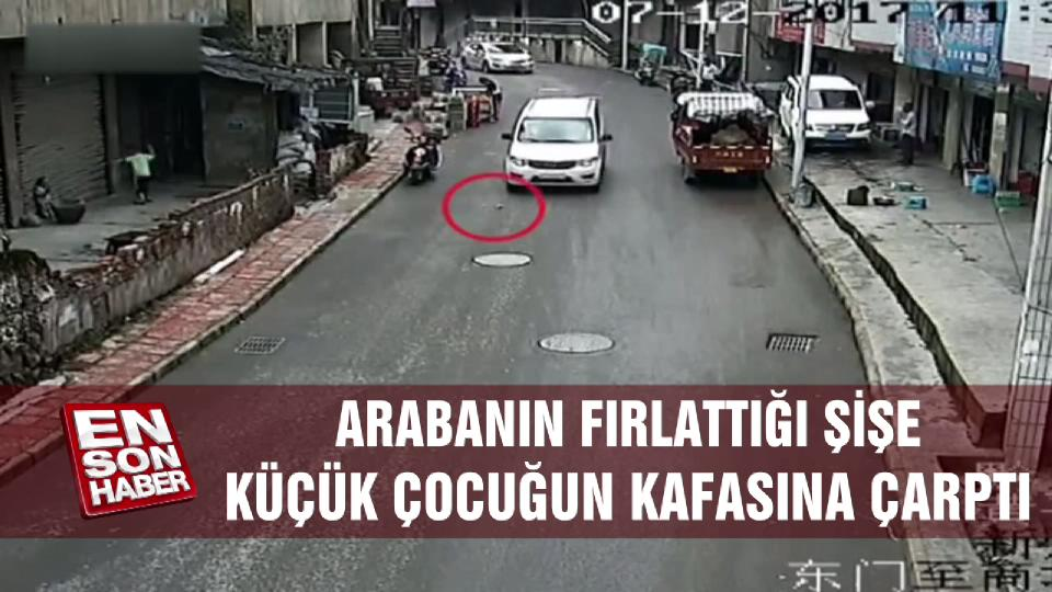 Arabanın fırlattığı şişe küçük çocuğun kafasına çarptı