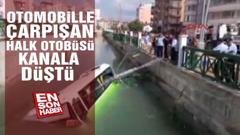 Otomobille çarpışan halk otobüsü kanala düştü