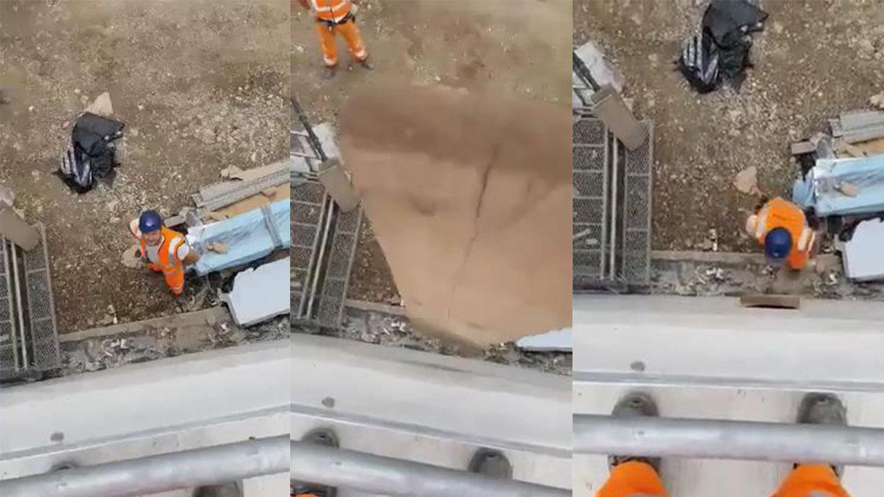 Yukarıdan atılan tahtayı kafasıyla yakalayan işçi