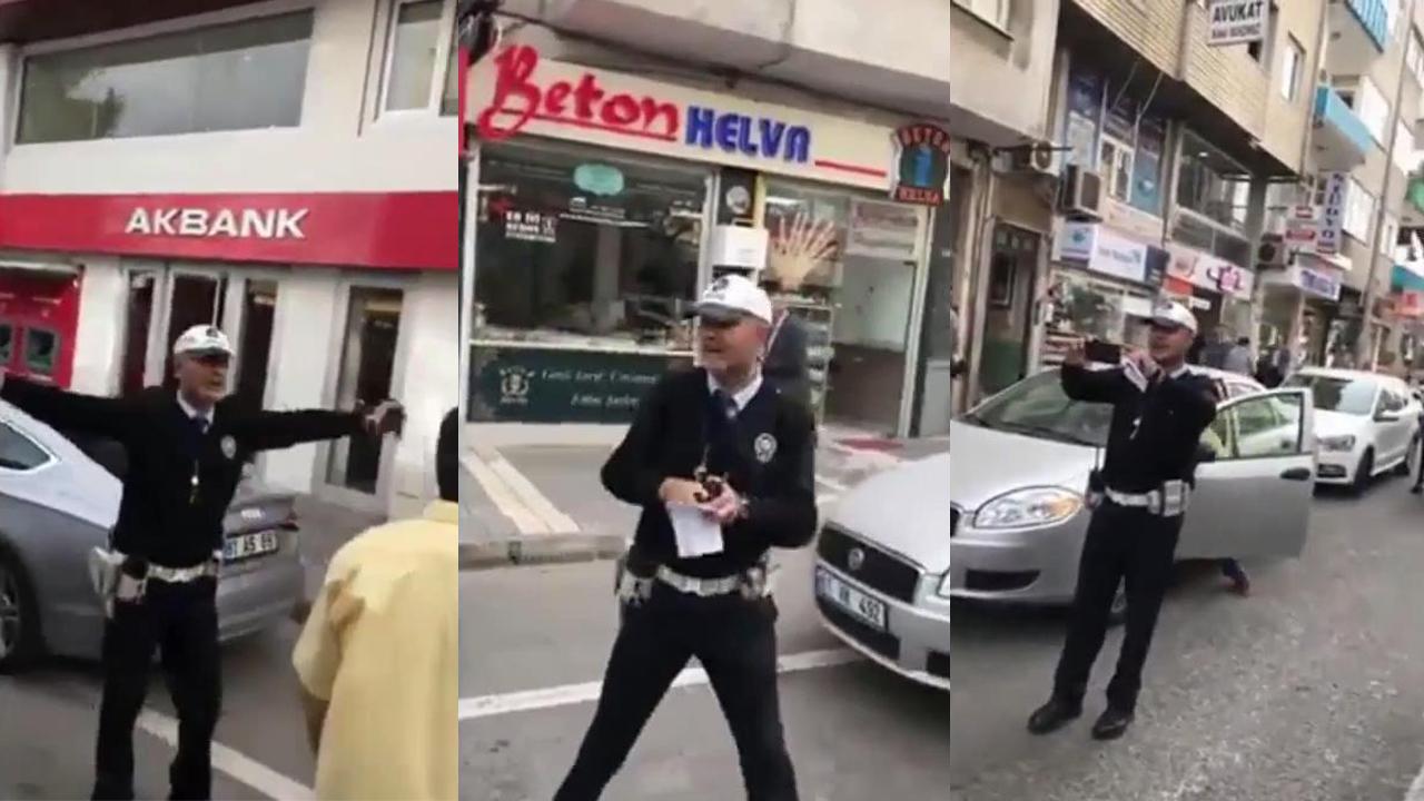 Ceza yazarken şarkı söyleyen trafik polisi