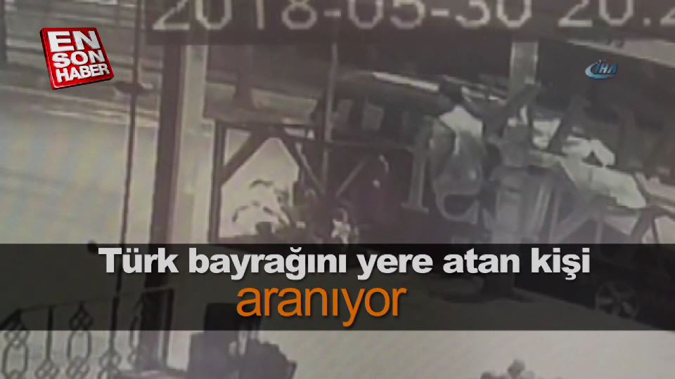 Türk bayrağını yere atan kişi aranıyor