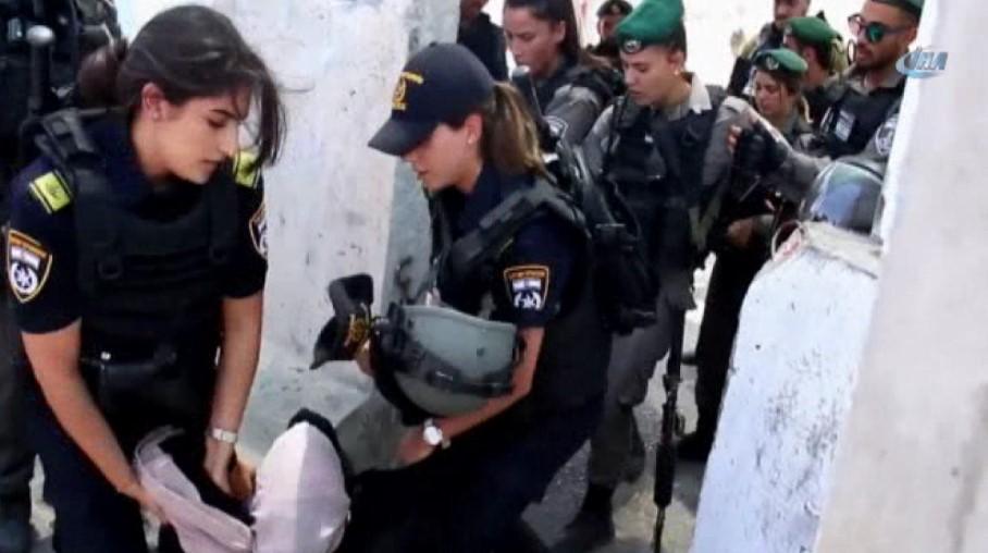 İsrail askerleri Filistinli kadını tartakladı