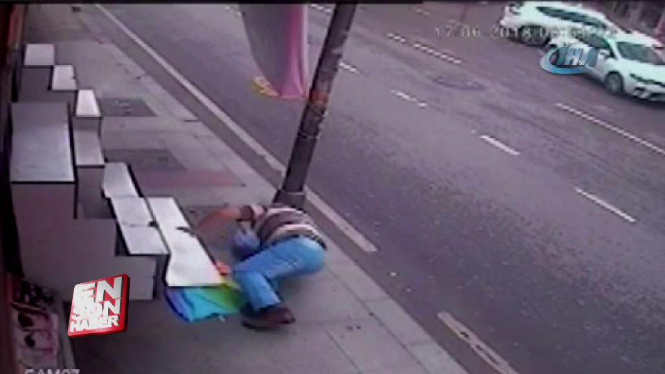 Şemsiye çalarken düşüp başını yardı